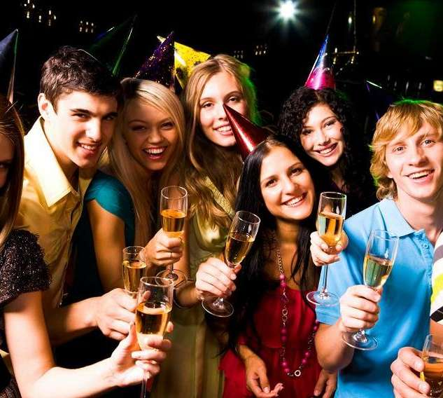 Portrait of glad people in smart clothing with champagne at birthday party